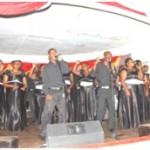 Black men singing on a stage