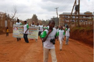Young africans walk through town to benefit the mission