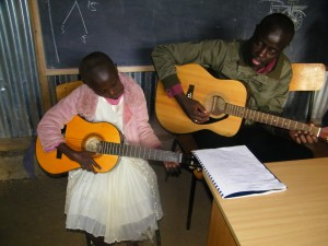 Naomi receives guitar lessons from Daden.