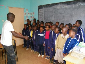 Edward directs Class 3/4 Choir.