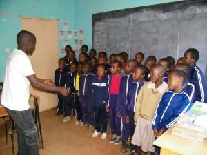 Edward directs Class 3/4 Choir.