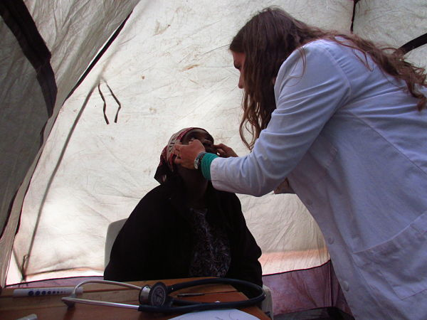 Nurse practitioner Grace Alpert seeing a patient in one of the camping tents used for examination rooms.