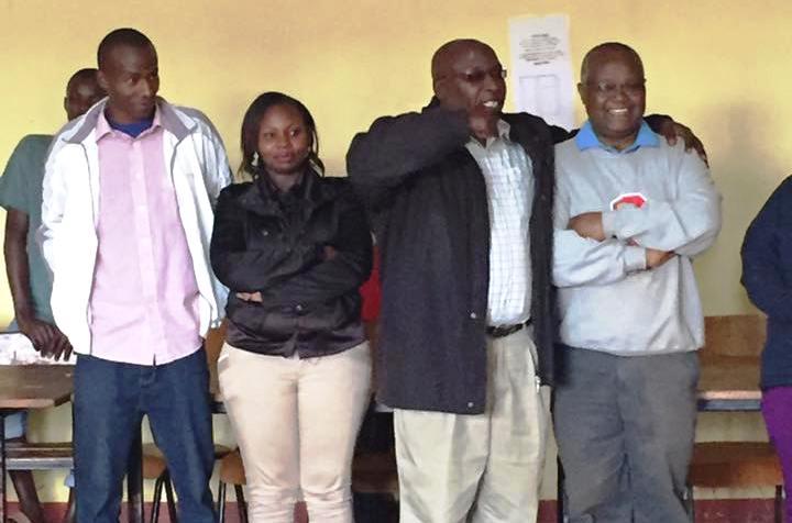 Martin Nyaga (Lab Technologist), Mercy Wandere (Nurse), Amos Kanja (Deputy Administrator) and Reverend John Nganga